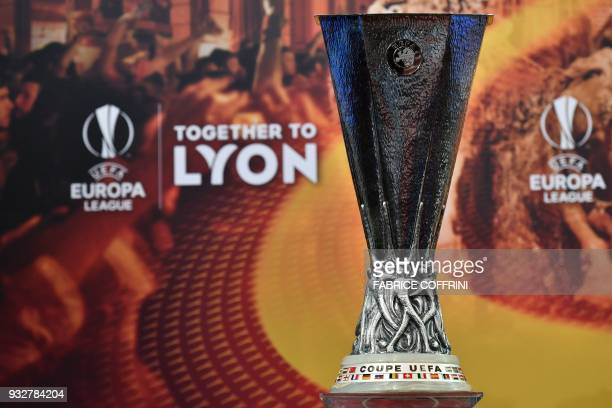 A picture taken on March 16 2018 shows the UEFA Europa League football cup during the draw for the quarter finals round of the UEFA Europa League...