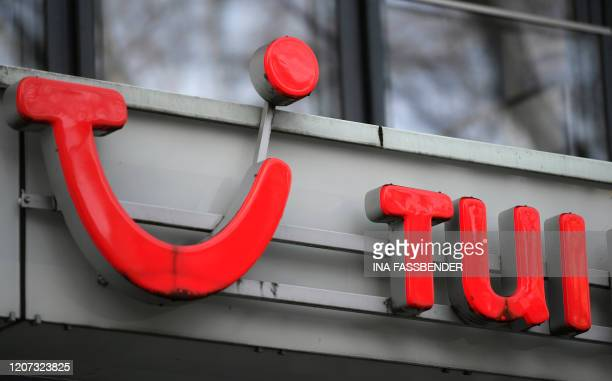 A picture taken on March 16 2020 shows the logo of German tour operator TUI at a shop in Dortmund German tourism giant TUI said it was suspending the...