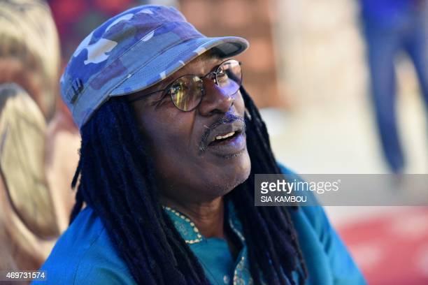 Picture taken on March 17, 2015 shows Ivorian reggae Alpha Blondy speaking during an interview at his radio station Alpha Blondy FM in Abidjan. His...