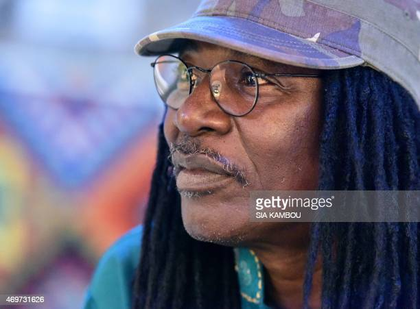 A picture taken on March 17 2015 shows Ivorian reggae Alpha Blondy looking on during an interview at his radio station Alpha Blondy FM in Abidjan His...