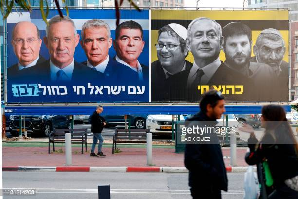 Picture taken on March 17, 2019 in the Israeli city of Ramat Gan in the suburbs of Tel Aviv shows a billboard bearing portraits of Blue and White...