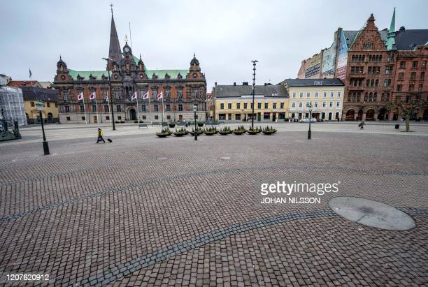 A picture taken on March 18 2020 shows the empty Stortorget square in Malmo Sweden where activities came to a halt due to the novel coronavirus /...