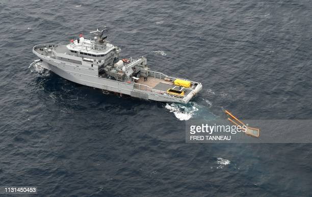 A picture taken on March 18 shows the French Navy ship BSAM Rhone carrying out cleanup operations in a pollution zone at sea 300 kms west of La...