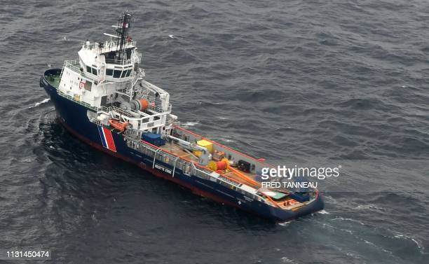 A picture taken on March 18 shows the Ship Argonaute in a pollution zone at sea 300 kms west of La Rochelle in the Gascogne Gulf off the western...