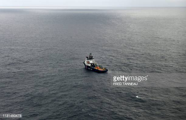 A picture taken on March 18 shows the ship VN Sapeur in a pollution zone at sea 300 kms west of La Rochelle in the Gascogne Gulf off the western...