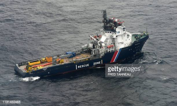 A picture taken on March 18 shows the the ship VN Sapeur in a pollution zone at sea 300 kms west of La Rochelle in the Gascogne Gulf off the western...