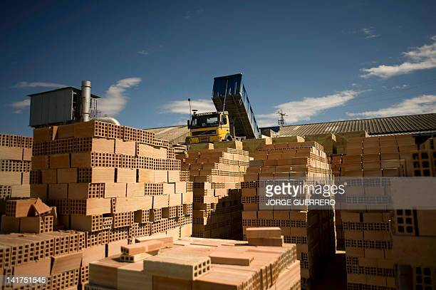 A picture taken on March 19 2012 shows a truck unloading clay in an active bricks factory in Bailen near Jaen In Bailen an Andalusian city entirely...