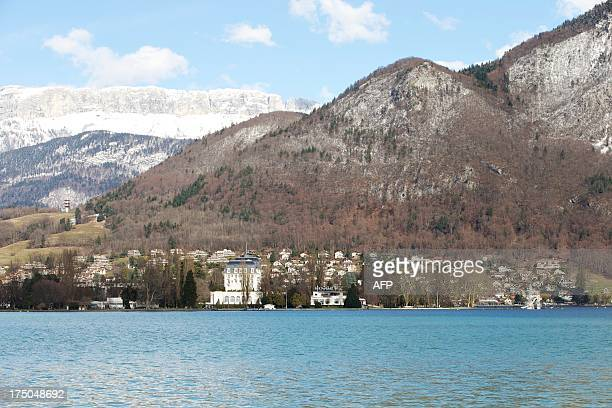 A picture taken on March 19 2013 shows the Imperial Palace hotel on the Albigny peninsula the shores of Annecy lake French Alps AFP PHOTO / PATRICE...