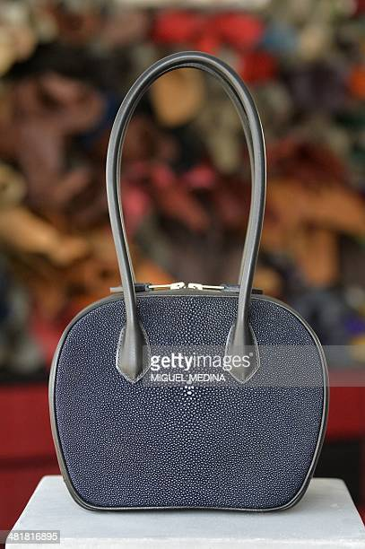 A picture taken on March 19 2014 shows a handbag made of shagreen and calf leather displayed at the workshop of French designer of luxury leather...