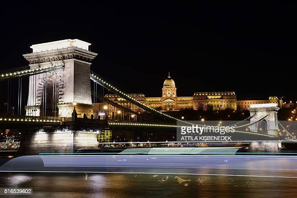 Picture taken on March 19 2016 shows the oldest Hungarian bridge the 'Chain Bridge' with the Buda Castle on top of the Castle Hill of Budapest...