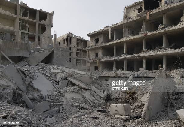 TOPSHOT A picture taken on March 19 2018 shows a general view of the damage in the Syrian Kurdish city of Afrin a day after Turkishled forces entered...