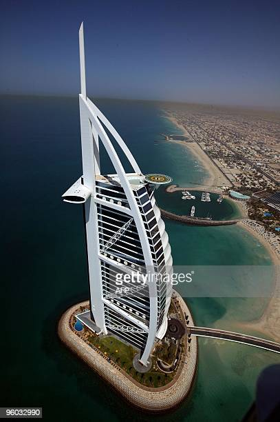 A picture taken on March 2 2004 shows an aerial view of Burj AlArab hotel in the Gulf emirate of Dubai The Gulf emirate of Dubai whose biggest...