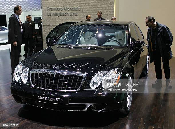 Picture taken on March 2 2005 shows visitors watching a Maybach 57 S car at its world premiere at the 75th Geneva Motor Show in Geneve Switzerland...