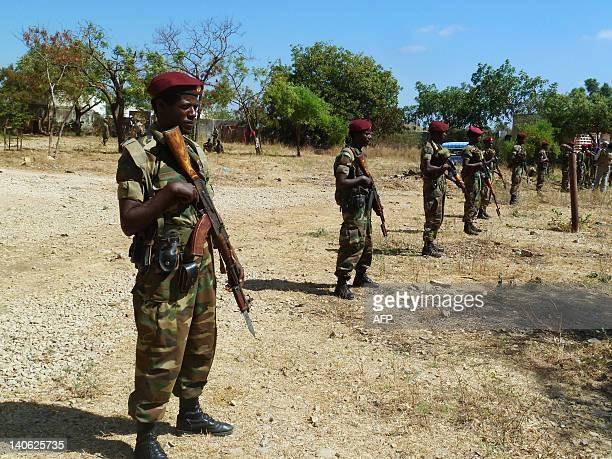 A picture taken on March 2 2012 shows Ethiopian soldiers standing guard before a display of weapons left behind by Shebab militias at their former...