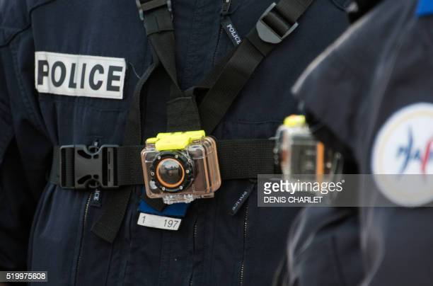 A picture taken on March 2 2016 shows a police officer wearing a bodyworn camera in Calais French Interior Minister Bernard Cazeneuve said on April 8...
