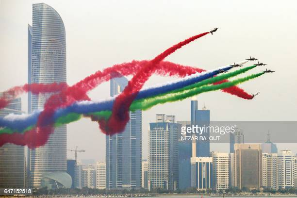 A picture taken on March 2 2017 in Abu Dhabi shows Emirati forces' planes performing in an airshow as part of the 'Union Fortress Live Military...