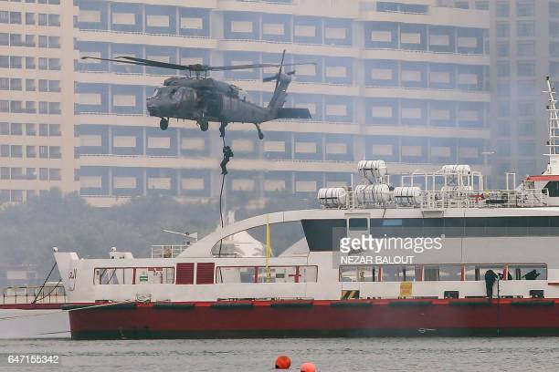 A picture taken on March 2 2017 in Abu Dhabi shows Emirati military forces rapelling from military helicopters during the 'Union Fortress Live...