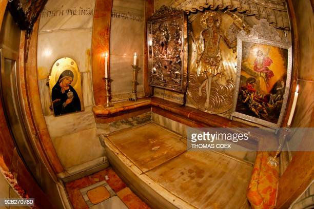 A picture taken on March 2 2018 with a fisheye lens shows the interior of the Holy tomb of Jesus Christ where his body is believed to have laid...