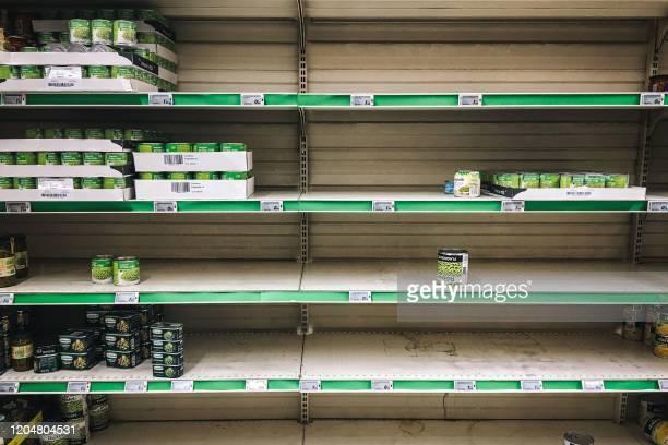 A picture taken on March 2 2020 shows empty stalls in a supermarket in the Qwartz shopping centre in VilleneuvelaGarenne north of Paris Supermarket...