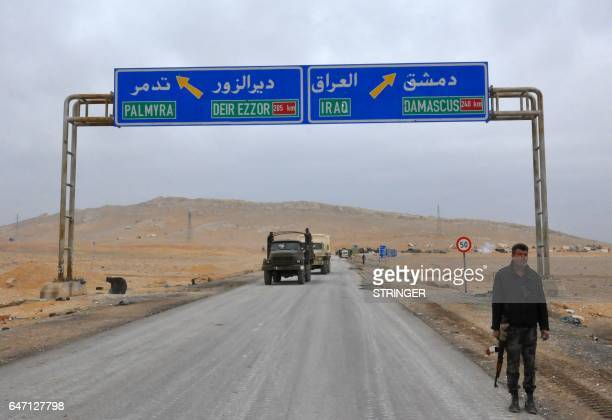 Picture taken on March 2 shows a sign displaying the routes to Palmyra-Deir Ezzor and Damascus-Iraq as Syrian regime fighters advance to retake the...