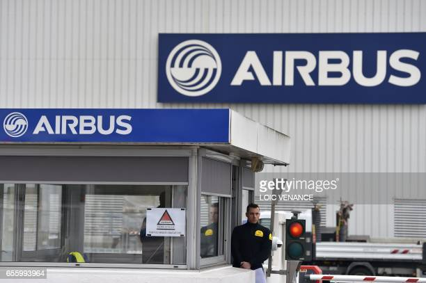 Picture taken on March 20, 2017 shows the entrance of the civil aircraft manufacturing company Airbus facility in Bouguenais, western France. / AFP...