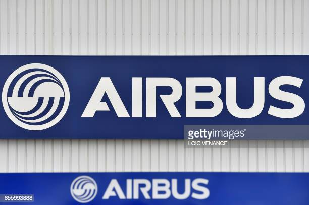 A picture taken on March 20 2017 shows the logo of the civil aircraft manufacturing company Airbus at the entrance of the Airbus facility in...