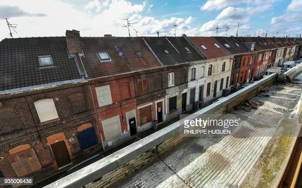 A picture taken on March 20 2018 in Roubaix northern France shows a view of a street with houses for sale for one euro against rehabilitation The...