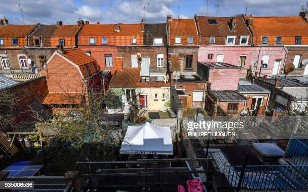 A picture taken on March 20 2018 in Roubaix northern France shows a view of a neighborhood with houses for sale for one euro against rehabilitation...