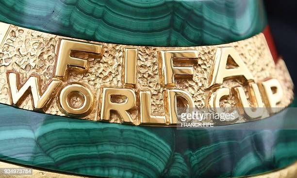 A picture taken on March 20 2018 shows a detail of the 2018 FIFA World Cup trophy during the FIFA World Cup Trophy Tour on in Paris The 2018 FIFA...