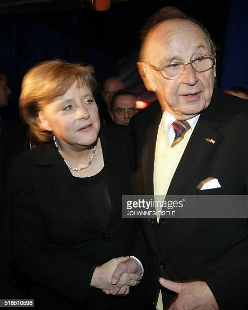 Picture taken on March 21 2007 shows German chancellor Angela Merkel congratulating Former German foreign minister HansDietrich Genscher at the...
