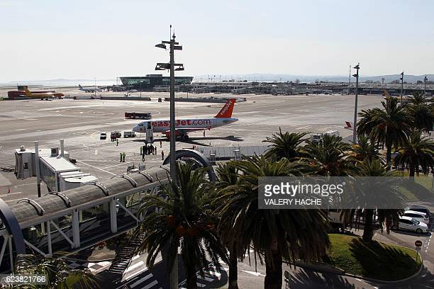 A picture taken on March 21 2012 shows a plane of British lowcost airline EasyJet on the airstrip of the new base of the company in Nice French...
