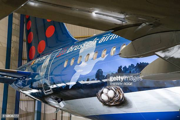 A picture taken on March 21 2016 in Zaventem shows an unique Magritte themed aircraft presented during a press conference of Brussels Airlines and...