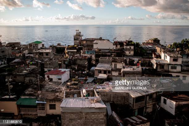 TOPSHOT Picture taken on March 21 2019 shows a general view of the Central Business district of Mutsamudu the capital of Anjouan Island Comoros...
