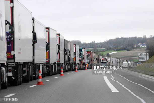 Picture taken on March 21, 2019 shows stopped trucks on the A26 highway trying to make their way to the Channel Tunnel, near Calais, northern France,...