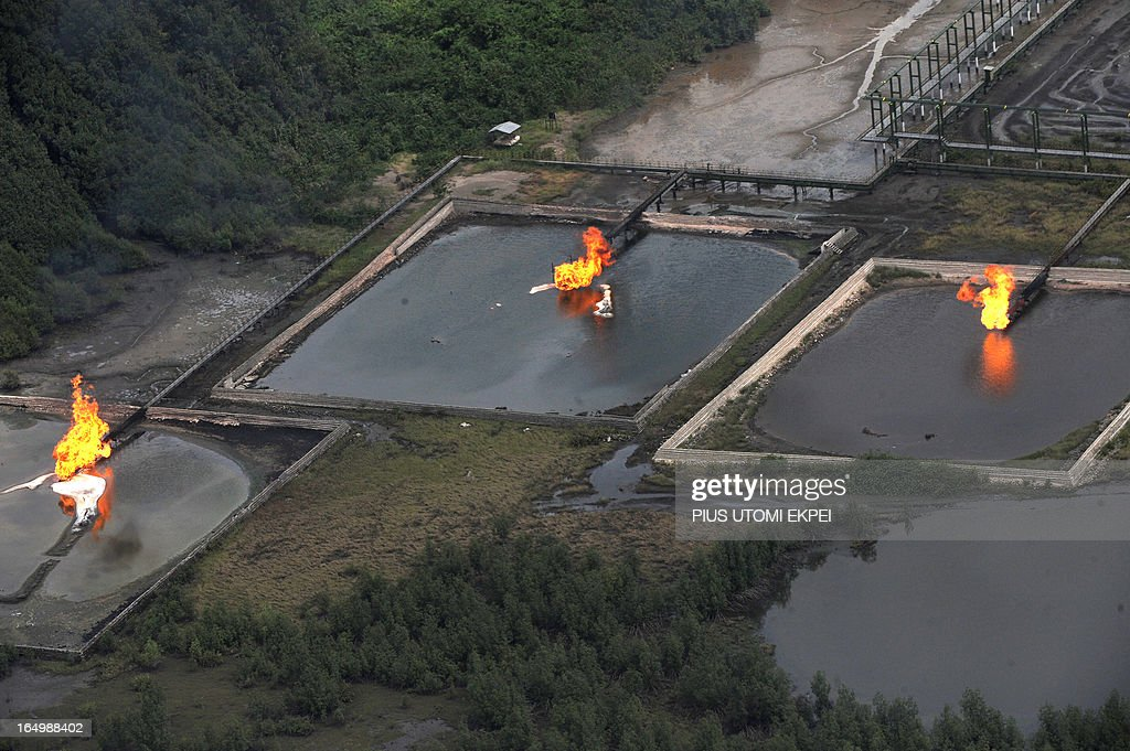 A picture taken on March 22, 2013 shows gas flare at Shell Cawtharine Channel, Nembe Creek in the Niger Delta. Shell Petroleum Development Company of Nigeria (SPDC) on April 2, 2013 said it would temporarily shut down production the Nembe Creek Truck Line (NCTL) to remove a number of bunkering points on pipelines vandalised by oil thieves in the region.