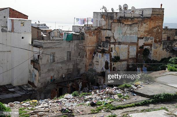 A picture taken on March 22 2013 shows rubbishes in front of houses in the Kasbah of Algerian capital Algiers The Kasbah is a Unesco World Heritage...