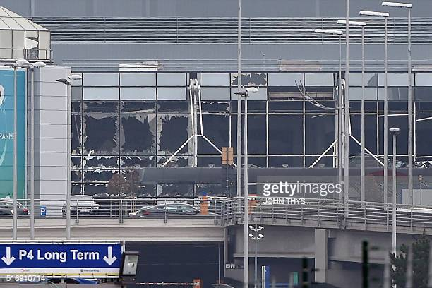 Picture taken on March 22, 2016 in Zaventem, shows the damaged facade of Brussels airport after at least 13 people were killed and 35 injured as twin...