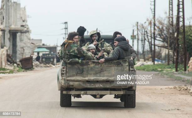A picture taken on March 22 2017 near the rebelheld town of Tayyibat alImam in the countryside of the central Syrian province of Hama shows rebel...