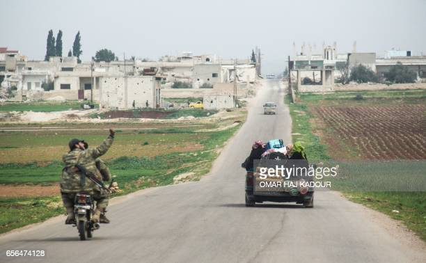 A picture taken on March 22 2017 near the town of alLataminah in the countryside of the central Syrian province of Hama shows a displaced Syrian...
