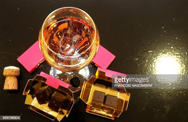 A picture taken on March 22 2018 in Reims shows a bottle of rose Champagne of Castelnau and chocolates with Espelette pepper made by master...