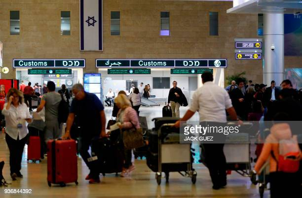 Picture taken on March 22, 2018 shows arriving passengers queueing for customs control at Ben Gurion International Airport on the outskirts of Tel...