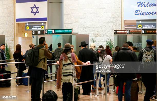 A picture taken on March 22 2018 shows arriving passengers queueing to present their travel documents before passport control at Ben Gurion...