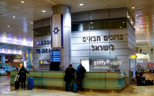 Picture taken on March 22, 2018 shows the Information and Ministry of Tourism booths at the arrival hall in Ben Gurion International Airport on the...