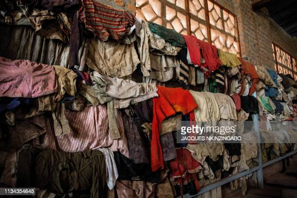 A picture taken on March 22 2019 shows cloths and belongings of the victims of the Rwanda's 1994 genocide's at the Ntarama Genocide Memorial in...