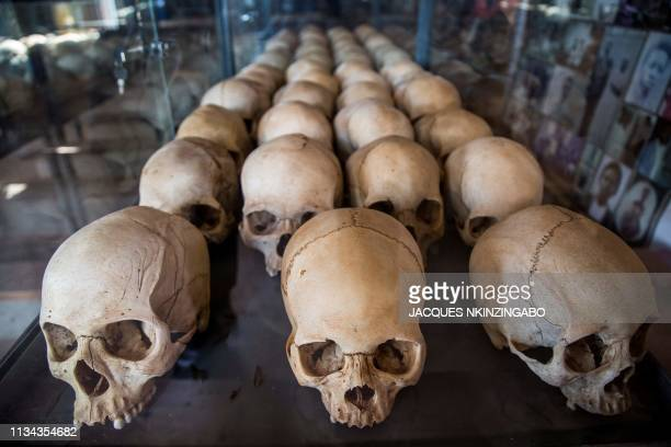 TOPSHOT A picture taken on March 22 2019 shows skulls of victims of the Rwanda's 1994 genocide's at the Ntarama Genocide Memorial in Kigali On April...