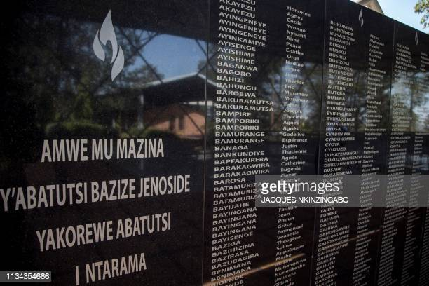 TOPSHOT A picture taken on March 22 2019 shows the names of the victims of the Rwanda's 1994 genocide's at the Ntarama Genocide Memorial in Kigali On...