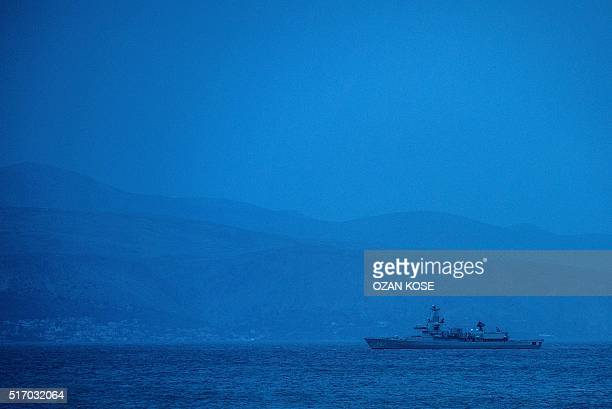 A picture taken on March 23 2016 from Cesme district in Izmir western Turkey shows a Dutch NATO warship patrolling the Aegean Sea between the Turkish...