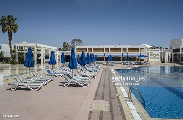 A picture taken on March 23 2016 shows an empty swimming pool at a hotel in the Egyptian Red Sea resort of Sharm elSheikh / AFP / KHALED DESOUKI