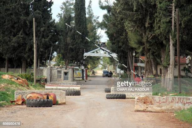 A picture taken on March 23 shows the entrance of a Syrian army military base in the village of Rahbet Khattab in the Hama province Jihadists and...