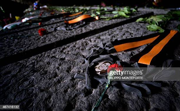 A picture taken on March 24 2015 in Rome shows a rose laying on a grave of the Ardeatine caves site and memorial cemetery on the 71st anniversary of...
